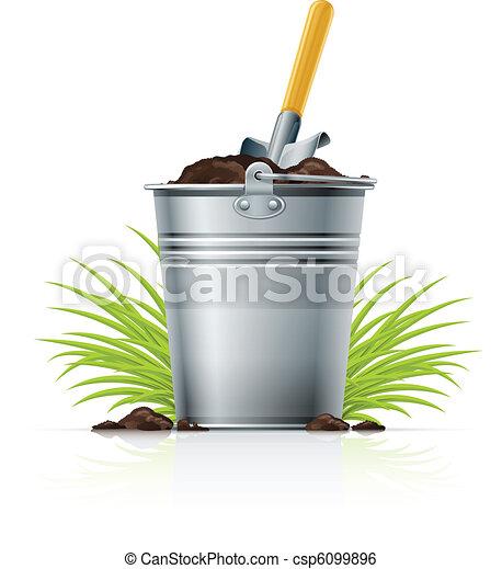 metallic bucket with ground and shovel - csp6099896