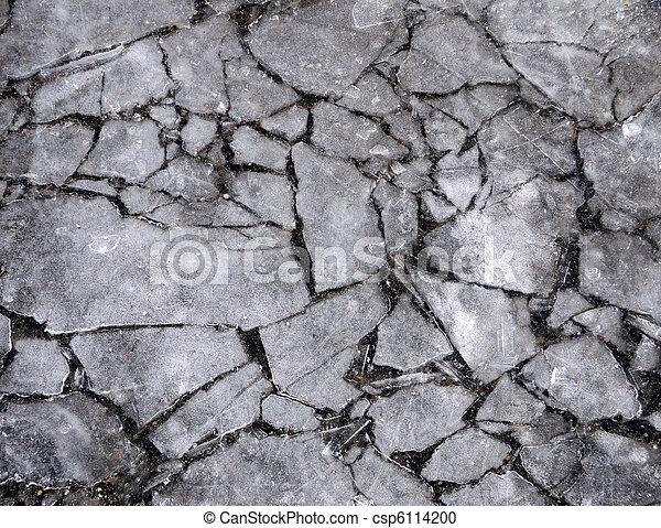 Cracked Ice over Sidewalk Pavement Background - csp6114200