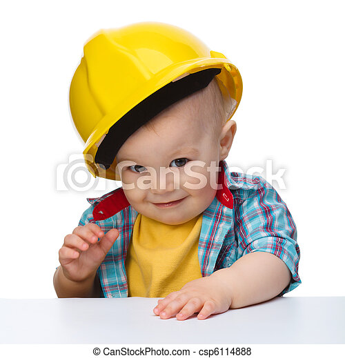 Cute little boy wearing oversized hard hat - csp6114888