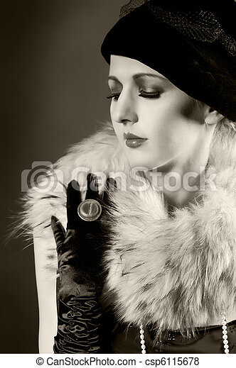 Retro styled fashion portrait of a young woman - csp6115678