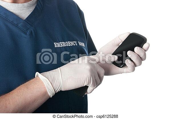 Emergency doctor or nurse uses smart phone - csp6125288