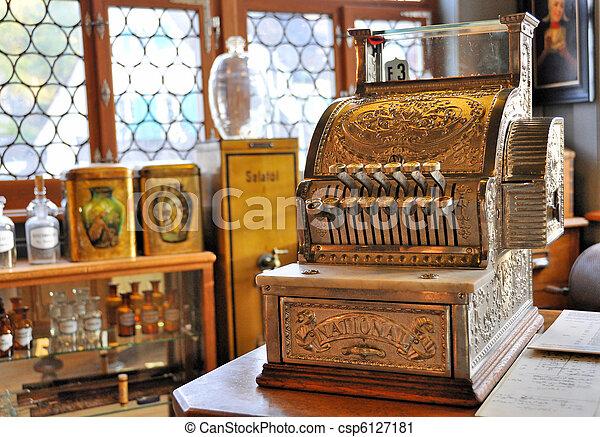Vintage cash register in an old pharmacy - csp6127181