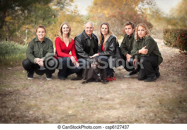 Attractive Family Pose for a Portrait Outdoors - csp6127437