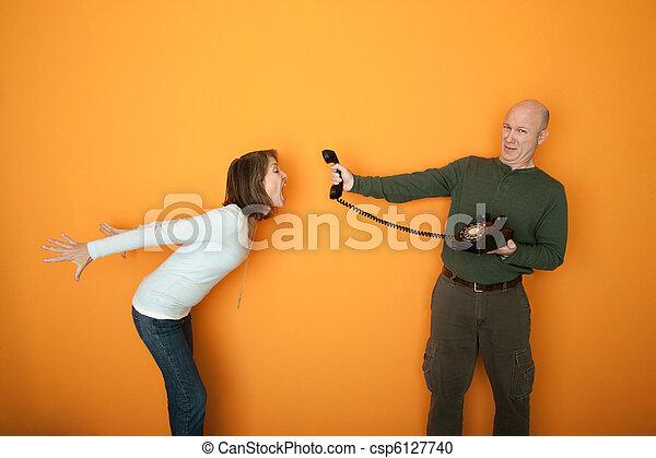 Woman Screaming On Telephone Conversation - csp6127740