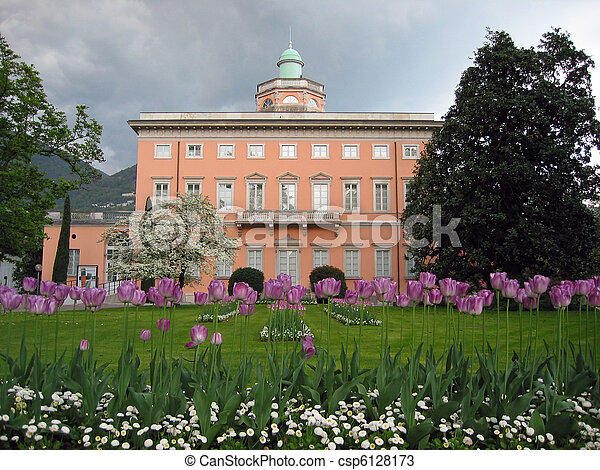 Classical mansion and lilac tulips in foreground. Lugano, Switzerland