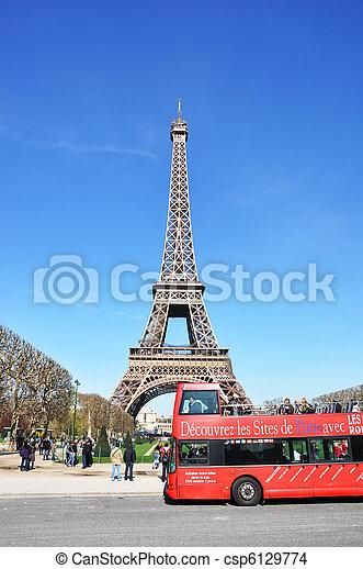 PARIS - APRIL 6: Excursion bus against Eiffel tower on April 6, 2010 in Paris. Eiffel tower is the most visited monument of France - csp6129774