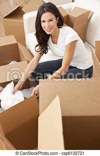 Single Woman Unpacking Boxes Moving House - csp6132721