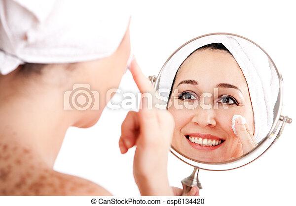 Facial skincare anti-ageing exfoliation - csp6134420