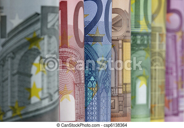 Rolled up Euro bills on white background - csp6138364