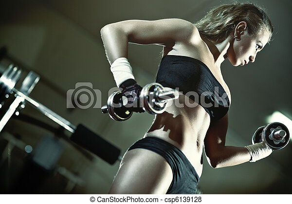 Young woman weight training - csp6139128