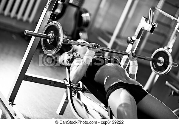 Young woman weight training - csp6139222