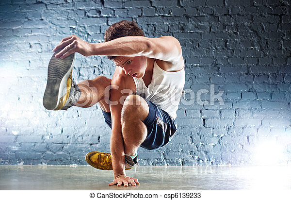 Young man sports exercises - csp6139233