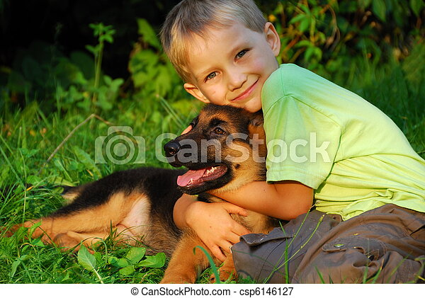 Boy hugging his dog - csp6146127