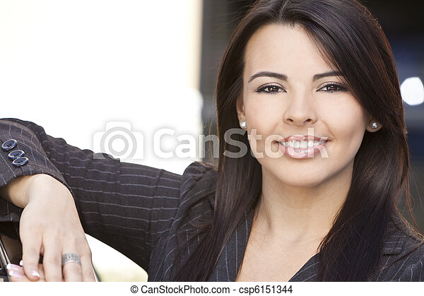 Beautiful Hispanic Woman or Businesswoman Smiling - csp6151344