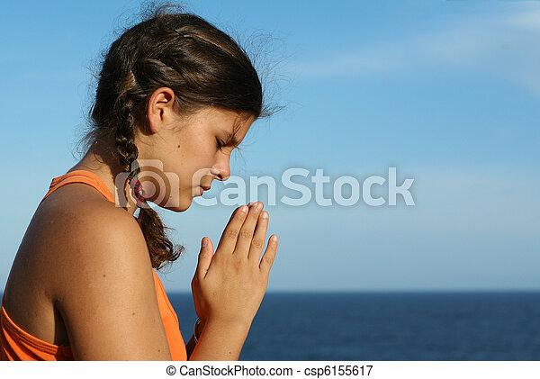 child praying outdoors - csp6155617