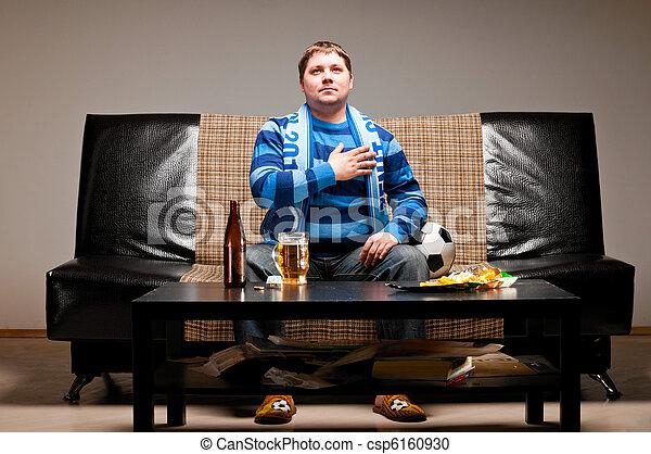 soccer fan on sofa - csp6160930