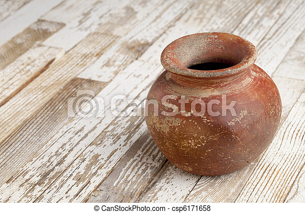red clay pot on rustic table - csp6171658