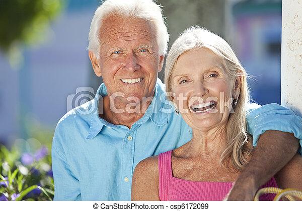 Happy Senior Couple Smiling Outside in Sunshine - csp6172099