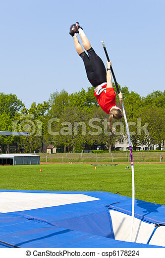 jumping over with the pole vault - csp6178224