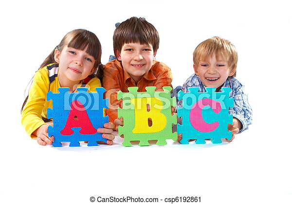 Children with Alphabet Puzzle - csp6192861
