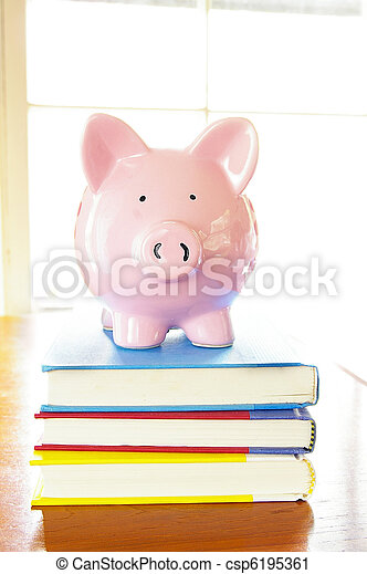 piggy bank on top of a stack of books - csp6195361