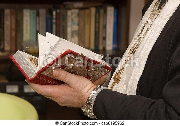 Preacher holding a bible - csp6195962