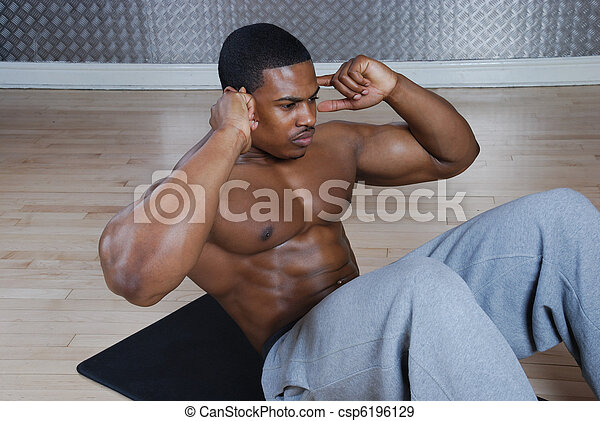African american doing sit ups and crunches - csp6196129