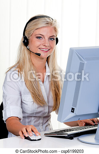 Woman at computer with headset and Hotline - csp6199203