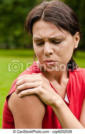 Shoulder injury - sportswoman in pain - csp6202039