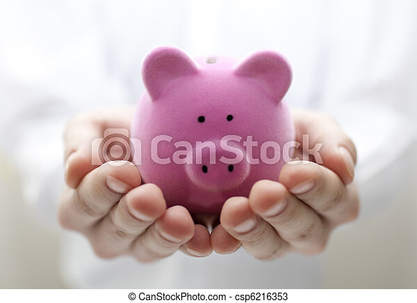 Man holding piggy bank. Shallow DOF - csp6216353