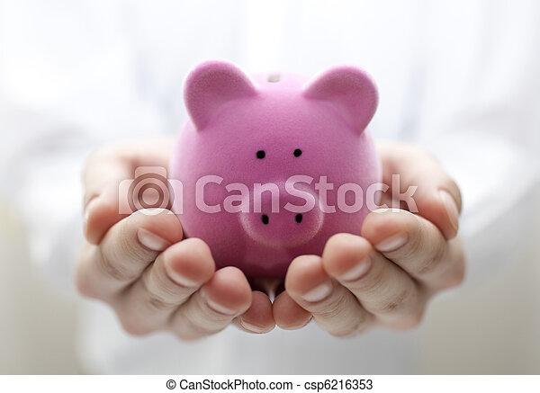 Man holding piggy bank. Shallow DOF - csp6216353