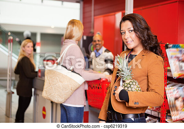 Portrait of a customer carrying pineapple - csp6219319