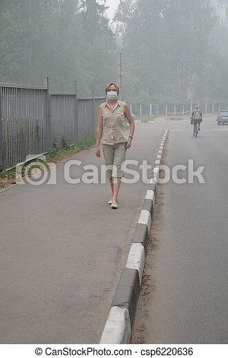 Woman walking in Heavy Smog - csp6220636