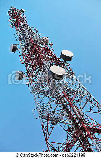 Telecommunication tower with antennas over a blue sky. - csp6221199
