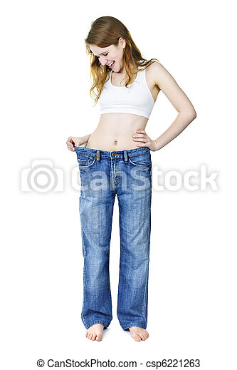 Happy girl in jeans after losing weight - csp6221263