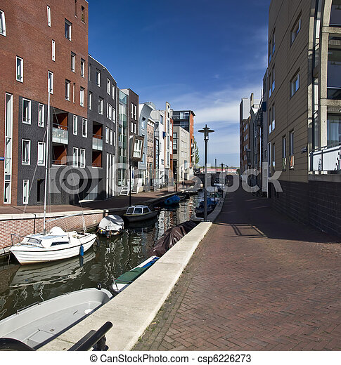 Modern residential houses on the canal in Amsterdam. Spring cityscape. - csp6226273