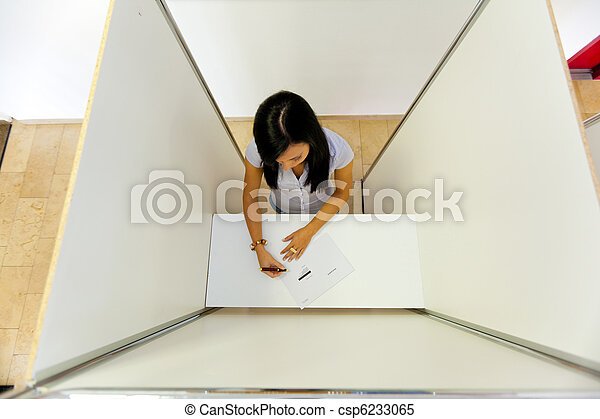 Woman in a voting booth - csp6233065