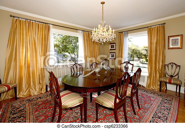 Dining room with yellow curtains and green walls - csp6233366