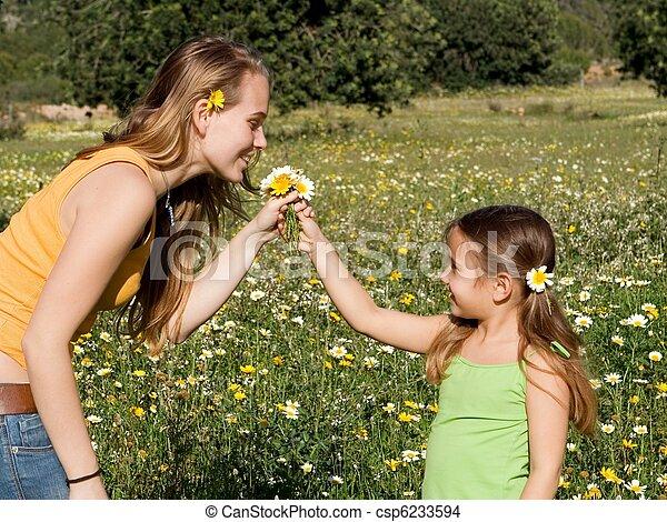 kid giving flower to mum - csp6233594