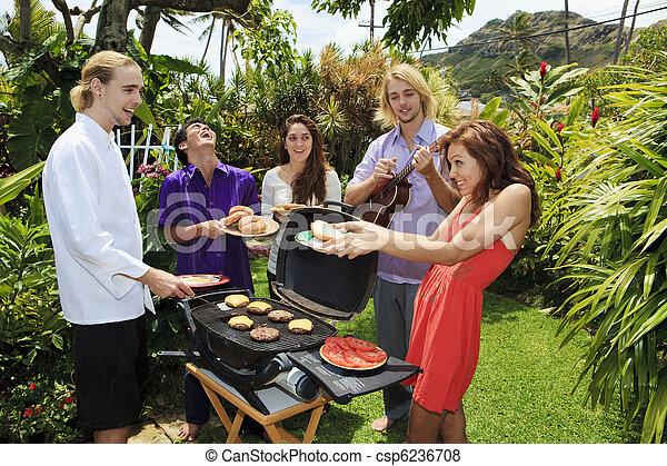 friends at a backyard bar-b-que in hawaii - csp6236708