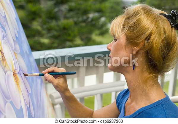 female artist painting on canvas - csp6237360