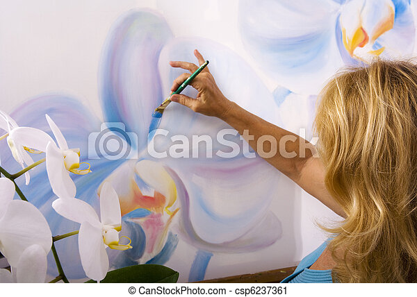 female artist painting phalaenopsis orchids on canvas in her studio - csp6237361