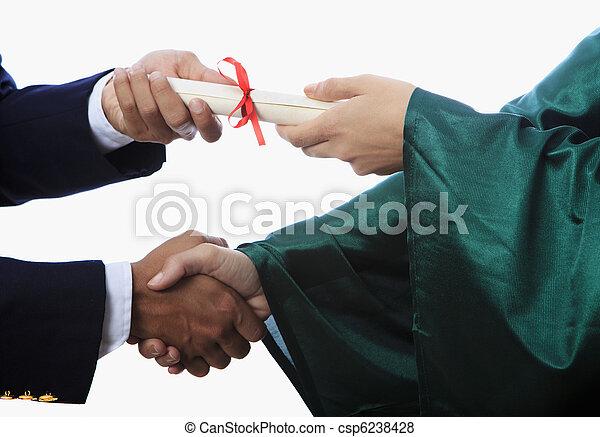 handshake and a diploma at graduation - csp6238428