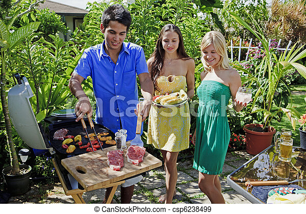 three friends having a barbecue lunch - csp6238499
