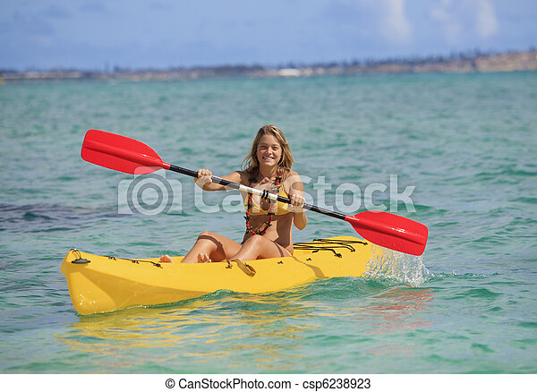 pretty teenage girl with her kayak