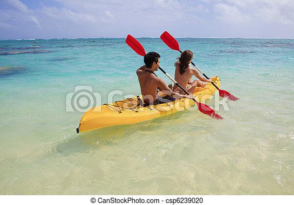 young couple kayaking in hawaii - csp6239020
