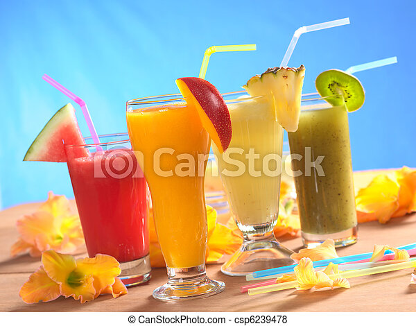 Mango, pineapple, watermelon and kiwi smoothie with drinking straws surrounded by gladiolus flower on wood (Selective Focus, Focus on the mango smoothie in the front) - csp6239478