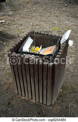 Stock Photo of Trash Bin in Public Park - An trash bin overstuffed ...