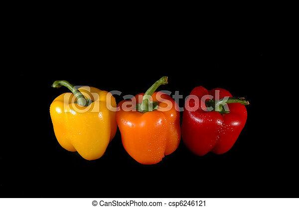 red, orange and yellow paprikas - csp6246121