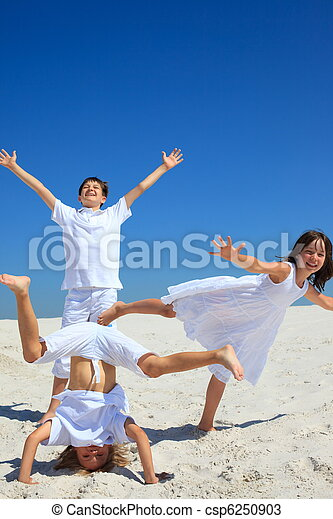 Happy siblings on beach - csp6250903
